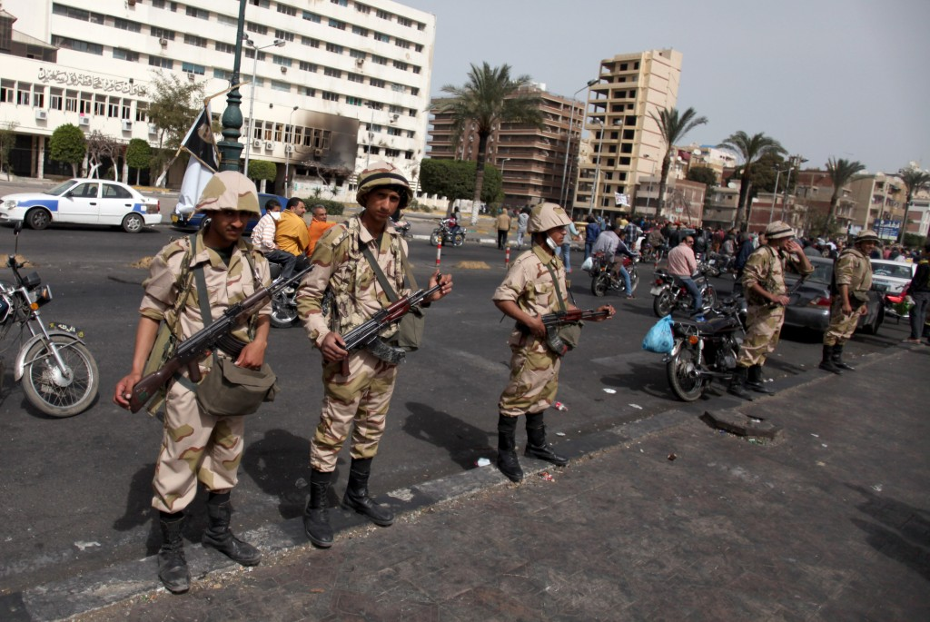 Egyptian military takes over for police in port said the times of egyptian army soldiers stand guard as they take control of the state security building after several publicscrutiny Gallery