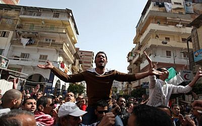 Egyptian protesters chant angry slogans during a demonstration after the noon prayer in Port Said, Egypt, Friday, March 8, 2013. With the country in chaos from weeks of protests against the Islamist president, the police have now joined the fray, launching their own protests (photo credit: AP/Khalil Hamra)