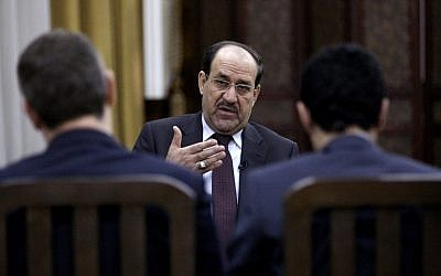 Iraq's Prime Minister Nouri al-Maliki speaks during an interview with The Associated Press in Baghdad, Iraq, Wednesday, Feb. 27, 2013 (photo credit: AP/Khaled Mohammed)
