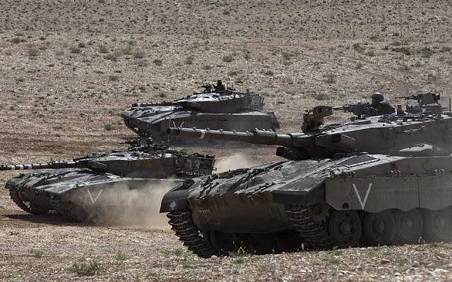 Israeli army tanks participate in a drill near Revivim, southern Israel, Thursday, March 7, 2013 (photo credit: AP/Sebastian Scheiner)