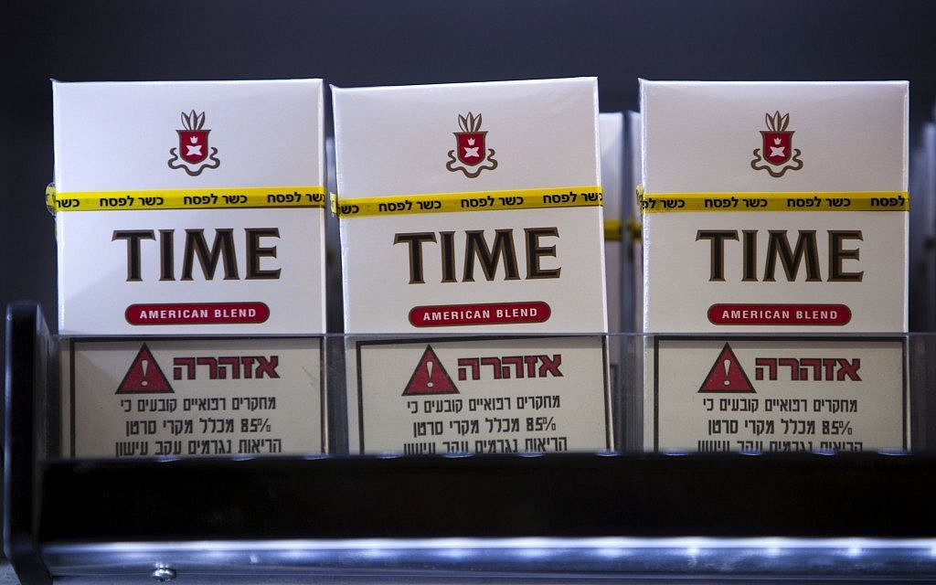 Cigarettes for sale with a stamp of approval reading in Hebrew 'Kosher for Passover' at a kiosk in the ultra-Orthodox town of Bnei Brak, near Tel Aviv, Monday, March. 25, 2013. (Photo credit: AP Photo/Oded Balilty)
