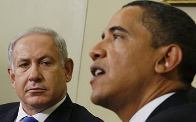 Prime Minister Benjamin Netanyahu, left, looks toward US President Barack Obama as he speaks to reporters in the Oval Office at the White House in Washington, March 2013 (AP Photo/Charles Dharapak, File)