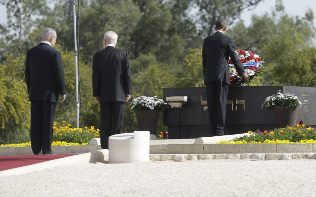 President Barack Obama, right, with President Shimon Peres and Prime Minister Benjamin Netanyahu, at the grave of Theodor Herzl during Obama's visit to Mt. Herzl in Jerusalem, Friday, March 22, 2013. (photo credit: AP Photo/Pablo Martinez Monsivais)