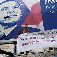 Palestinian activists throw shoes at a poster of US President Barack Obama in the West Bank city of Bethlehem, Monday, March 18, 2013. (photo credit: AP/Nasser Shiyoukhi)