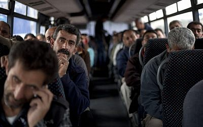 Palestinian laborers ride a Palestinian-only bus en route to the West Bank from working in Tel Aviv area, Israel, Monday, March 4, 2013. (photo credit: AP/Ariel Schalit)