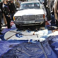 A man drives his car over a poster of US President Barack Obama in the West Bank city of Bethlehem, Monday, March 18, 2013. (photo credit: AP/Nasser Shiyoukhi)
