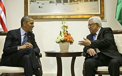US President Barack Obama, left, listens to Palestinian President Mahmoud Abbas during a meeting at the Muqata Presidential Compound in the West Bank city of Ramallah, last March (photo credit: AP/Pablo Martinez Monsivais/File)