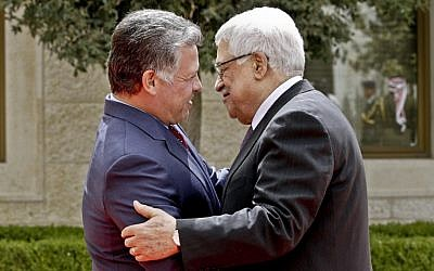 King Abdullah II of Jordan, left, welcomes Palestinian Authority President Mahmoud Abbas after his arrival at the Royal Palace in Amman, Jordan, in March, 2013. (AP Photo/ Raad Adayleh)