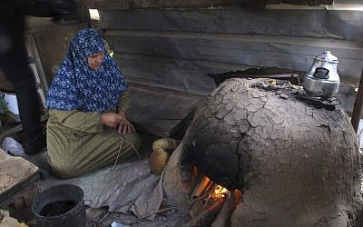 In this Monday, March 18, 2013 photograph, Palestinian Nabila Qishta, 52, prepares bread in the southern Gaza Strip town of Rafah, using flour donated by the UN (photocredit: AP/Diaa Hadid)