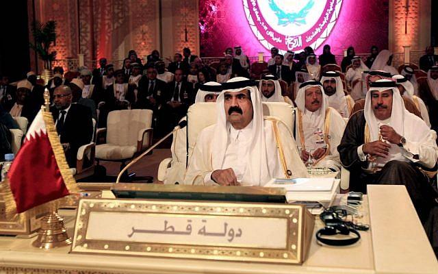 Emir of Qatar Sheik Hamad Bin Khalifa Al Thani, center, attends the opening session of the Arab League Summit in Doha, Qatar, Tuesday. (AP Photo/Ghiath Mohamad)