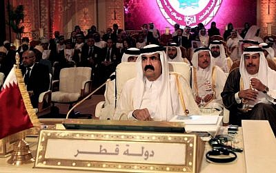 Emir of Qatar Sheik Hamad bin Khalifa Al Thani, center, attends the opening session of the Arab League Summit in Doha, Qatar in March 2013. (photo credit: AP/Ghiath Mohamad)
