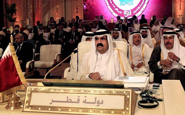 Emir of Qatar Sheik Hamad bin Khalifa Al Thani, center, attends the opening session of the Arab League Summit in Doha, Qatar in March 2013. (photo credit: AP/Ghiath Mohamad)