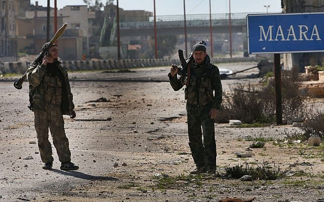 Free Syrian Army fighters patrol in Syria, February 2013. (photo credit: AP/Hussein Malla)