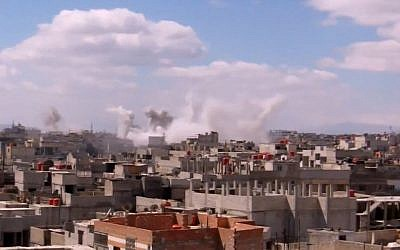 Columns of smoke rise from heavy bombing by Syrian government forces in Arbeen, Syria, on Monday March 18, 2013. (photo credit: AP/Shaam News Network via AP video)