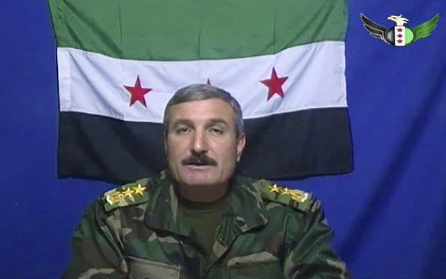 Syrian Commander Riad al-Asaad appears on a video posted on the Free Syrian Army's Facebook page (photo credit: AP/Free Syrian Army)