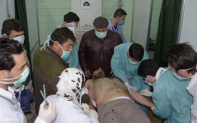 A victim of an alleged chemical weapons attack is treated by doctors in Aleppo, Syria, in March (photo credit: AP/SANA)