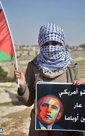 An anti-Obama Palestinian protester, location unknown (photo credit: Facebook/Quds News Network)
