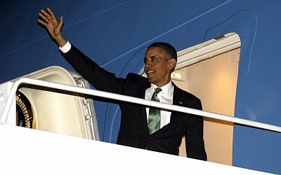 US President Barack Obama waves as he boards Air Force One during his departure from Andrews Air Force Base, Md., Tuesday, March 19 (photo credit: AP/Pablo Martinez Monsivais)