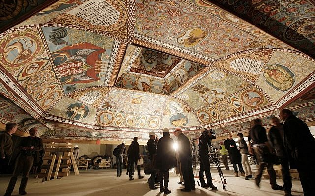 Visitors inspect the painted ceiling of a reconstructed wooden synagogue at Warsaw's Museum of the History of Polish Jews. (Czarek Sokolowski/AP)