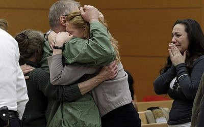 A family member hugs David Ranta after Judge Miriam Cyrulnik freed him in New York State Supreme Court on Thursday (Richard Drew/AP)