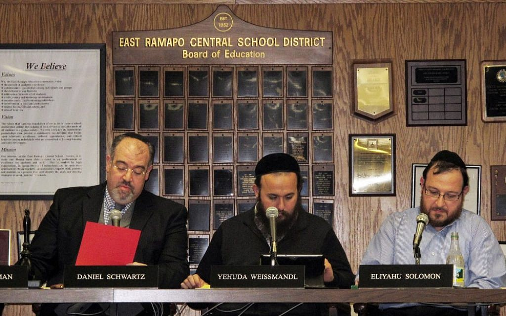 East Ramapo School Board President Daniel Schwartz and board members Yehuda Weissmandl and Eliyahu Solomon attend a board meeting on Tuesday, March 19, 2013, in Spring Valley, New York. (photo credit: AP/Jim Fitzgerald)