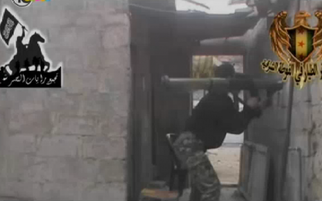 Al-Qaeda fighters near the Israel-Syria border (photo credit: Channel 10 screenshot)