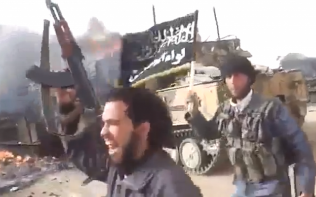 Illustrative photo of al-Qaeda-linked fighters after an attack on a Syrian army convoy in March, 2013. (screen capture: YouTube)
