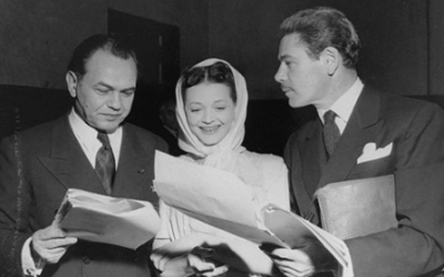 Edward G. Robinson, left, and Silvia Sydney, two Jewish actors who changed their names to work in Hollywood, review the We Will Never Die script with director Billy Rose. (Courtesy of the David S. Wyman Institute for Holocaust Studies)