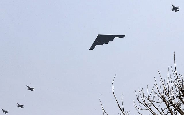 A US Air Force B-2 stealth bomber flies over near Osan US Air Base in Pyeongtaek, south of Seoul, South Korea, March 28, 2013 (AP/Shin Young-keun, Yonhap)