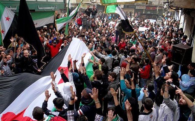 Anti-Syrian regime protesters in Aleppo, Syria, Friday March 15, 2013 (photo credit: AP Photo/Aleppo Media Center, AMC)
