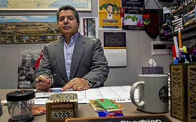 Dr. Najib Ghadbian sits in his office at the University of Arkansas. Ghadbian was recently named a Syrian opposition representative for the United States. (photo credit: AP/Gareth Patterson)