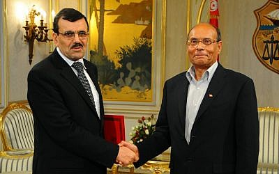 Tunisian Prime Minister Ali Larayedh, right, shakes hands with Tunisian President Moncef Marzouki, left, in Tunis on Friday, March 8 (photo credit: AP/Hassene Dridi)