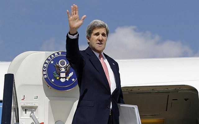 US Secretary of State John Kerry waves as he boards his plane in March (photo credit: AP/Jacquelyn Martin)