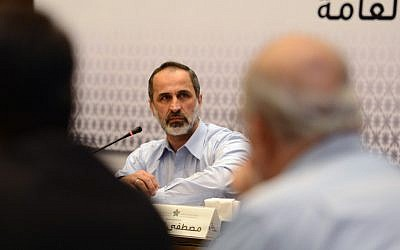 Head of the Syrian National Coalition Moaz al-Khatib speaks during a meeting in Istanbul, Turkey, Monday, March 18, 2013. (photo credit: AP)