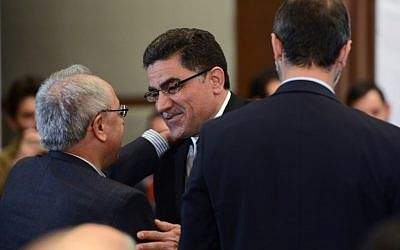 Ghassan Hitto, the Syrian opposition's newly elected interim prime minister, center, is congratulated by other members after a press conference in Istanbul, Turkey, Tuesday (photo credit: AP)