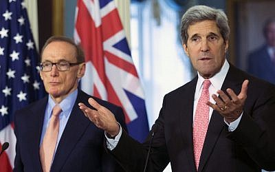 US Secretary of State John Kerry, accompanied by Australian Foreign Minister Bob Carr, gestures as he speaks to reporters following their meeting at the State Department in Washington on Monday. (photo credit: AP/Manuel Balce Ceneta)