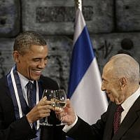 US President Barack Obama and President Shimon Peres toast after Obama receives the Israeli Medal of Distinction from Peres during a state dinner at the presidential residence in Jerusalem, Thursday. (AP Photo/Pablo Martinez Monsivais)