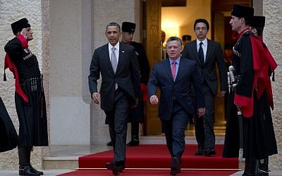 US President Barack Obama walks with Jordan's King Abdullah II to participate in an official arrival ceremony at the Al-Hummar Palace on Friday, March 22, 2013, in Amman, Jordan. (photo credit: AP/Carolyn Kaster)