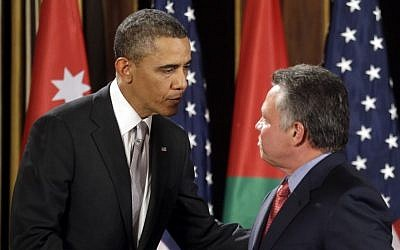 US President Barack Obama, left, and Jordan's King Abdullah II shake hands following a joint press conference at the King's Palace in Amman, Jordan, on Friday, March 23, 2013. (photo credit: AP/Pablo Martinez Monsivais)