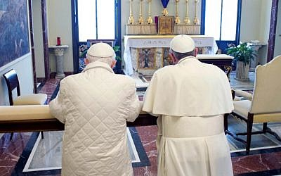 In this photo provided by the Vatican paper L'Osservatore Romano, Pope Francis, right, and Pope emeritus Benedict XVI pray together in Castel Gandolfo Saturday. (AP Photo/Osservatore Romano, HO)