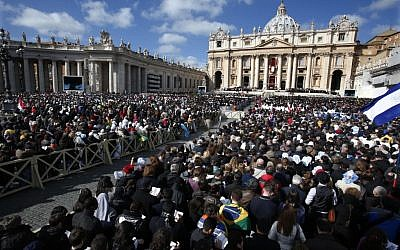 File: Crowds gather in St. Peter's Square for the inauguration Mass for Pope Francis at the Vatican, Tuesday, March 19, 2013. (photo credit: AP/Michael Sohn)