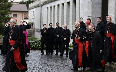 From left, US Cardinals Justin Francis Rigali, Donald Wuerl, Timothy Dolan, Francis George and Roger Mahony leave the North American College to go to the Vatican's Domus Sanctae Martae, the Vatican hotel where the cardinals stay during the conclave, in Rome, on Tuesday March 12, 2013. (photo credit: AP Photo/Alessandra Tarantino)