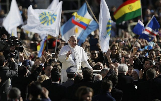 Pope Francis waves to crowds as he arrives at his inauguration Mass in St. Peter's Square at the Vatican, on Tuesday, March 19, 2013. (photo credit: AP Photo/Gregorio Borgia)