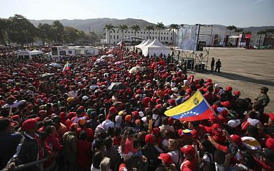 People gather outside the military academy where the funeral ceremony for Venezuela's late President Hugo Chavez will take place in Caracas, Venezuela, Friday, March 8, 2013. (photo credit: AP/Fernando Llano)