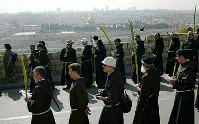Catholic priests carrying palm fronds to  commemorate Palm Sunday on Jerusalem's Mount of Olives (illustrative photo: Pierre Terdjman/Flash90).