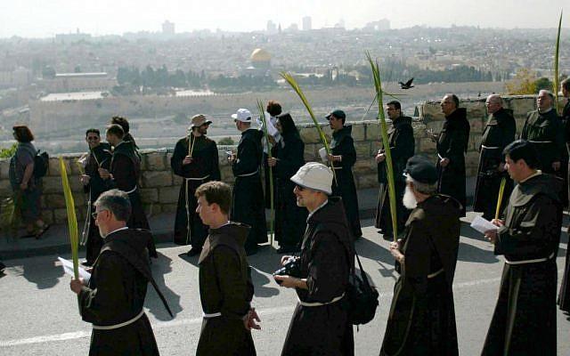 Catholic priests carrying palm fronds to  commemorate Palm Sunday on Jerusalem's Mount of Olives (illustrative photo: Pierre Terdjman/Flash90).