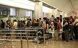 Illustrative: People stand in line to go through passport control at Ben Gurion International Airport in Israel, September 21, 2008. (Yossi Zamir/Flash90)