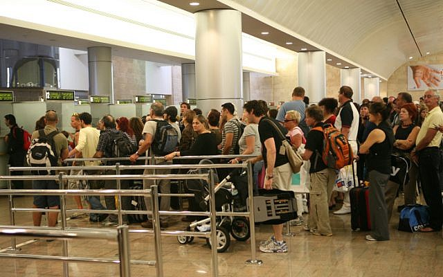 Illustrative: People stand in line to go through passport control at Ben-Gurion International Airport in Israel, September 21, 2008. (photo credit: Yossi Zamir/Flash90)