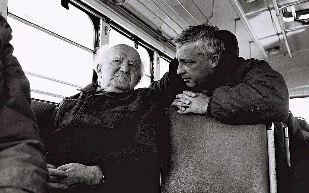 David Ben Gurion (left) and then-major general Ariel Sharon during a bus ride along the Israeli army positions on the Egyptian border in 1973. (IDF/Flash90)