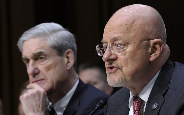 File: US Director of National Intelligence James Clapper, right, accompanied by FBI Director Robert Mueller, testifying on Capitol Hill in Washington. (AP/Susan Walsh)